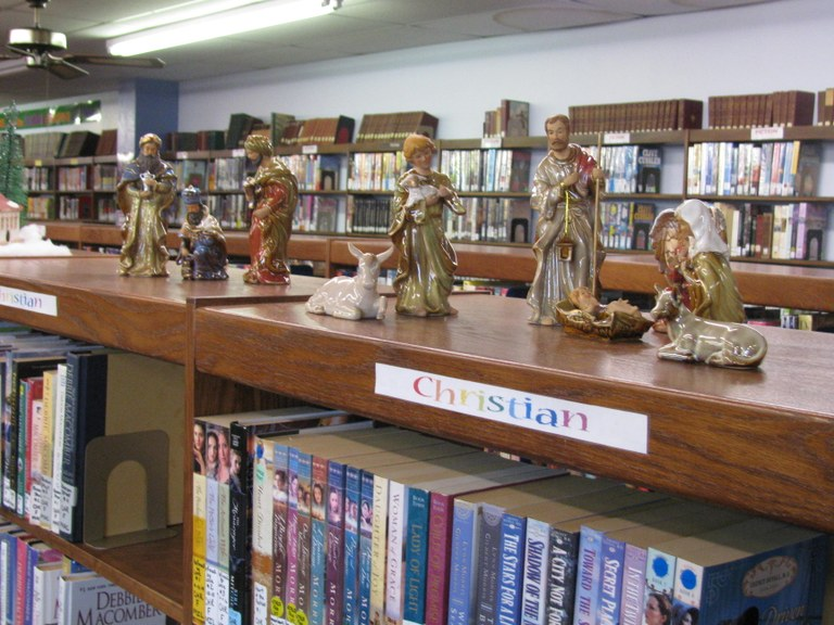 THE DECORATING OF THE LIBRARY