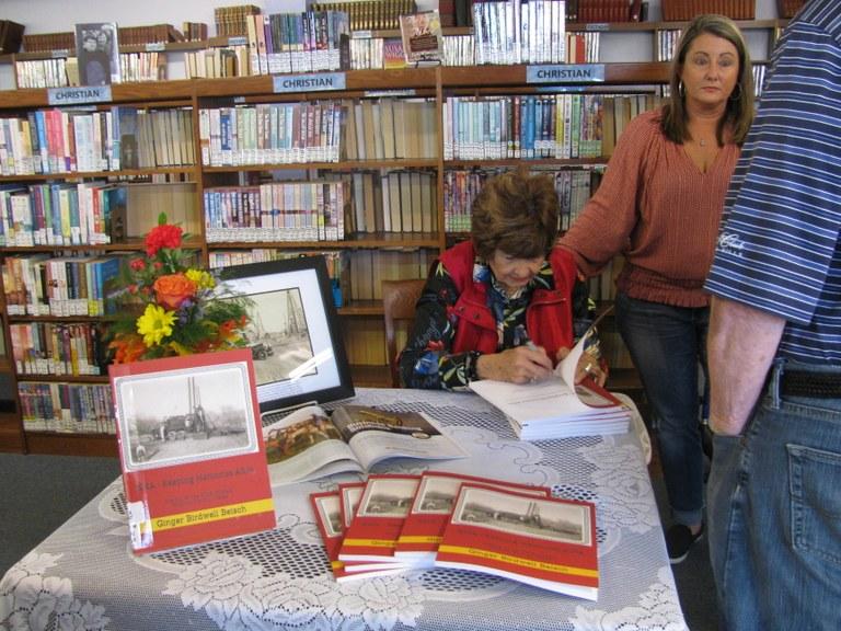 Ginger Beisch signing her book.JPG