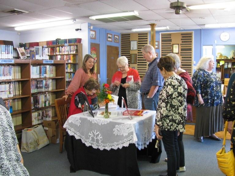 Ms. Beisch busy signing her books.JPG
