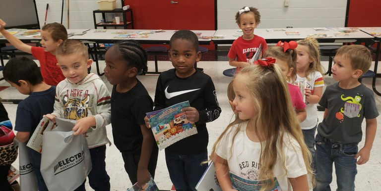 HALF OF THE HEADSTART CLASS WITH THEIR NEW BOOKS.jpg