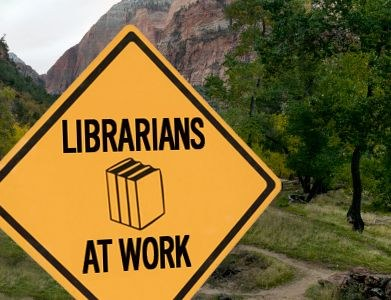 librarians at work sign